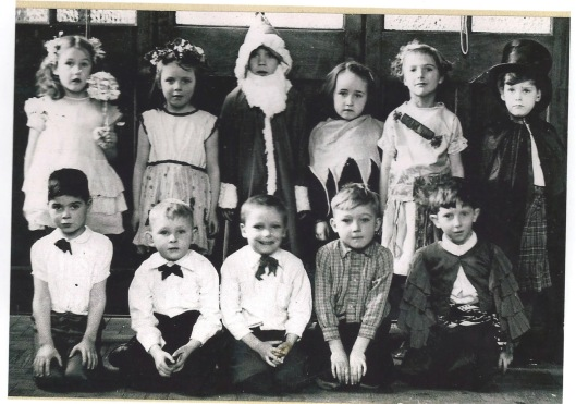 A Christmas group in about 1949, at Chipping Hill School, Church Street The children are said to be: Back row: Ann Goodchild (fairy), Janet McGraw (nee Smith, author, holly and ivy), David Snowden (Father Christmas), Margaret Cross (nee Mead, plum pudding and custard), Janet Thurston (Christmas cracker), Peter Scott. Front row: Michael Pavelin, Michael Woolnough, Alan McElrea, Brian Worship, Colin Shute