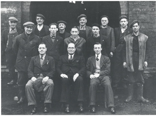 Workers at Witham Gas works in 1951. Standing, left to right (both rows), Jim Meekings (fitter etc. and mains), Harry Hazel (yard foreman, lived in gasworks house), ???, Herbert (Bert) King (fitter), Bill Grimsey (yard labourer), John Palmer (mains and service), Stan Hailey (stoker), John Metzinger (German POW, stoker), Seth Trehearne (stoker), 'Jack' Svoboda (German POW), Eric Gould (stoker). Sitting, left to right, George Bradley (collector), Arthur E Perry (manager), Dick Jones (clerk in office).