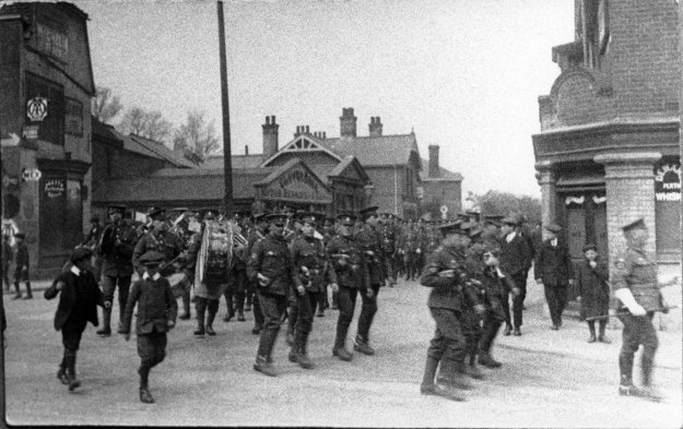 Some of the Royal Army Medical Corps and their band, in April 1915. They were attached to the 2nd/7th Battalion of the Warwickshire Regiment, recently arrived after the departure of the 1st/7th. They're coming down Collingwood Road; the George is on the right, and Glovers' motor works is on the left