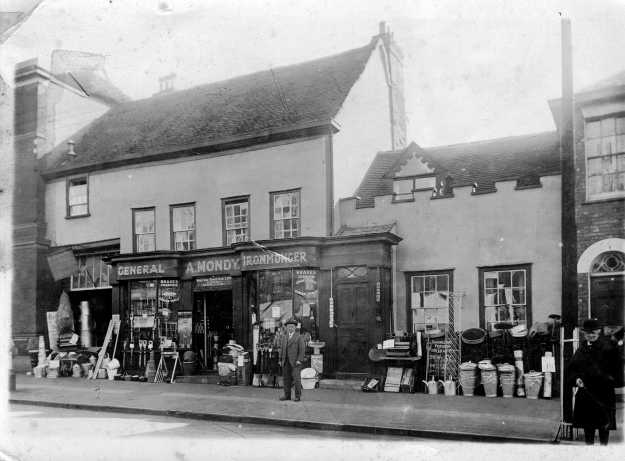 The shop and Mr Mondy in about 1930. Thanks to Nyria Atkinson, his granddaughter, for this. Note there was nothing plastic in those days. The living room was on the right in the part that looks like a castle.