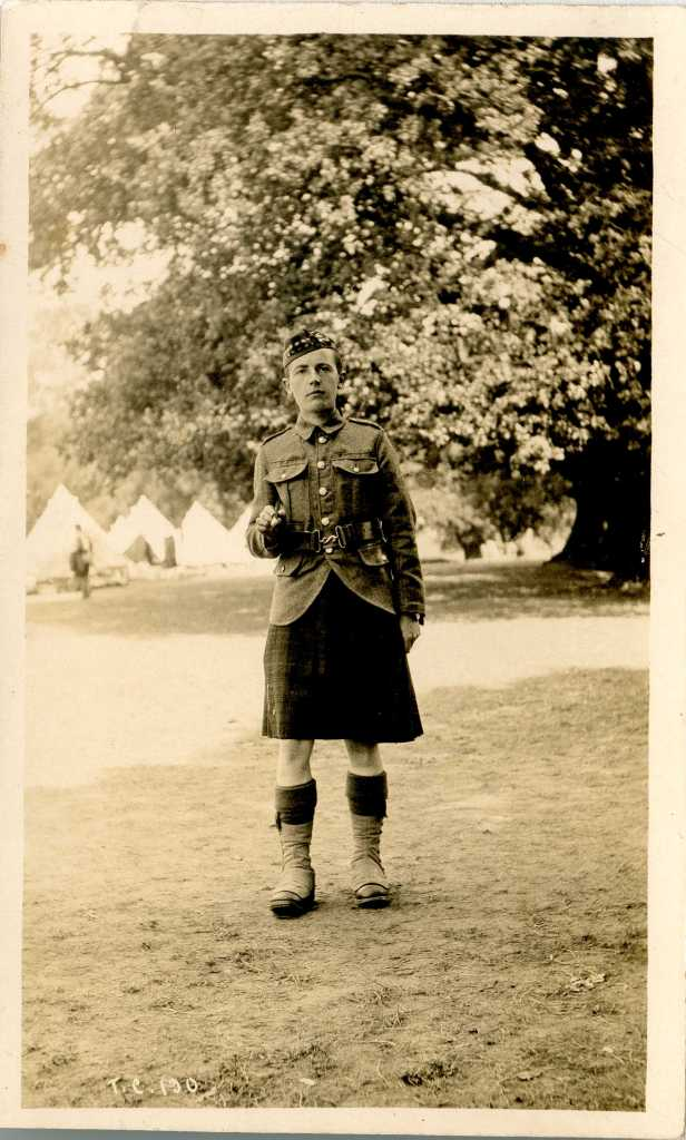 "A Scots soldier in the Avenue fields in 1916. His first name was Lewis. He was ""a piper with 2/4th or 2/5th Royal Scots Fusiliers, according to the ever helpful Ian Hook. He sent this photo to his aunt Bella. The tents on the left would accommodate soldiers looking after horses and equipment (m1449)"