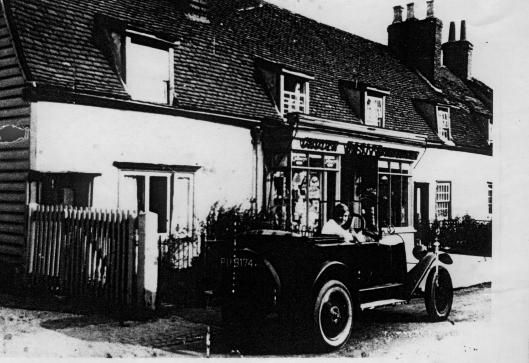 Dorcas Hasler in Mr Hasler's car outside his shop